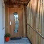Lesena fasada Kamnik vhod vrata